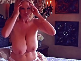 Huge-chested Blonde Kelly Madison Takes Off Her Underwear On A Sofa