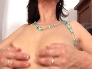 Horny Mom Massaging Her Raw Vulva