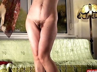 Doris Dawn Showcases Her Assets And Hairy Coochie On The Couch