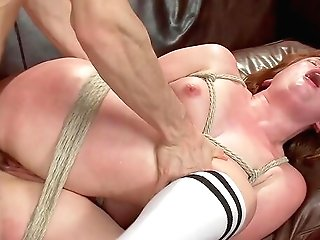 Naked Bitch Plays Obedient In The Face Of A Gigantic Pile Of Dicks
