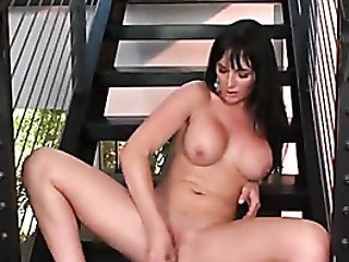 Big Tits Cougar Sits On Stairs And Masturbates