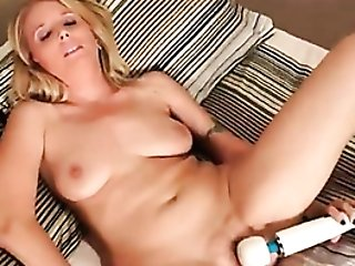 Cougar In Satin Undergarments Masturbates With Massager