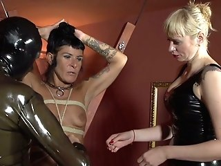 Perverted Mistress Lorena Lee And One Perverted Chick Penalize Chisel Of Enslaved Dude In Spandex