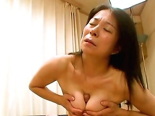 Hairy Japanese Granny Akiko Oda Laying On Her Back Having Intercourse