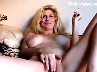 Matures Blonde Smokes And Masturbates