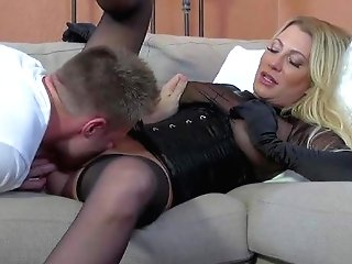 Horny And Arousing Blonde Mummy In Sexy Underwear And Corset
