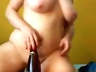 Sexy Mummy With Massive Baps Rails A Bottle
