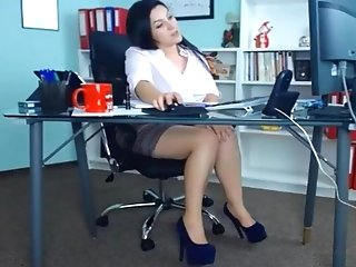 Sexy Dark Haired Cougar Playing At Work