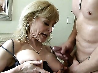 A Cougar Gets Jizz Shot On Her Tits