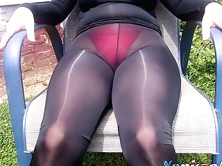 I Am Out In My Backyard Again This Time Wearing My Sexy Sheer Spandex.