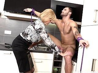 Matures Blonde Seductress Fucks A Junior Dude In The Kitchen
