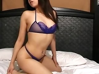 Slender Youthfull Kyoko Leans Over To Display Off A Sexy Butt In A Purple G-string
