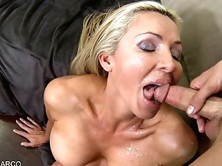 Blonde Cougar Gets Sprayed In The Face With Spunk!