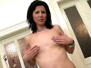 Dark Haired Stylish Matures Cougar Phylis Strips At Home